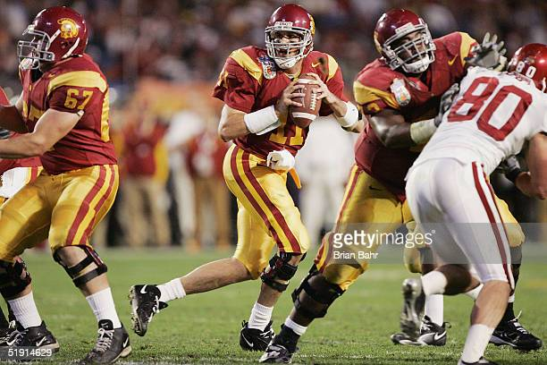 Quarterback Matt Leinart of the USC Trojans drops back to throw a pass against the Oklahoma Sooners defense in the third quarter during the FedEx...