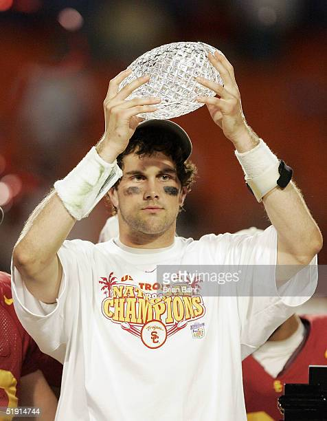 Quarterback Matt Leinart of the USC Trojans holds up the championship trophy after defeating the Oklahoma Sooners 5519 to win the FedEx Orange Bowl...