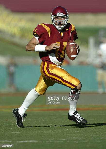 Quarterback Matt Leinart of the USC Trojans looks down field for an open receiver as he rolls out against the BYU Cougars on September 6, 2003 at the...