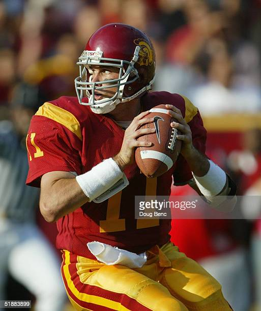 Quarterback Matt Leinart of the USC Trojans looks to pass against the Washington Huskies at the Los Angeles Coliseum on October 23, 2004 in Los...