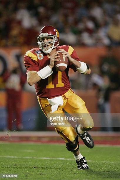 Quarterback Matt Leinart of the USC Trojans looks to pass against the Oklahoma Sooners in the 2005 FedEx Orange Bowl National Championship on January...