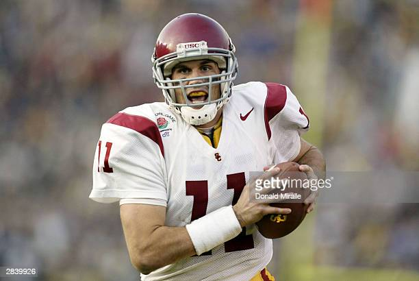Quarterback Matt Leinart of the USC Trojans scores a touchdown against the Michigan Wolverines during the 2004 Rose Bowl on January 1 2004 at the...