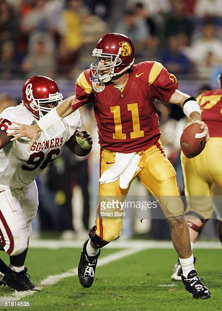 Quarterback Matt Leinart of the USC Trojans scrambles with the football against the Oklahoma Sooners defense in the second quarter during the FedEx...