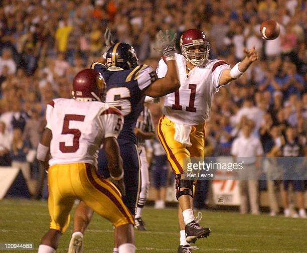 USC quarterback Matt Leinart passes under pressure from BYU Shaun Nau to Regiie Bush who ran 21 yards for a touchdown during the second quarter at...