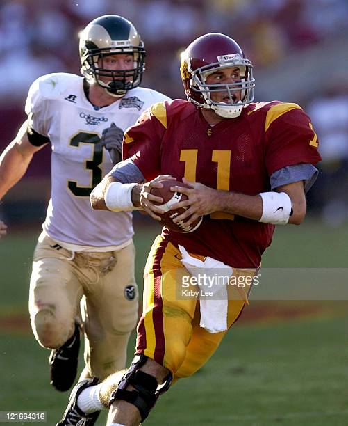 USC quarterback Matt Leinart scrambles from Ben Stratton of Colorado State during 490 victory at the Los Angeles Memorial Coliseum on Saturday Sept...