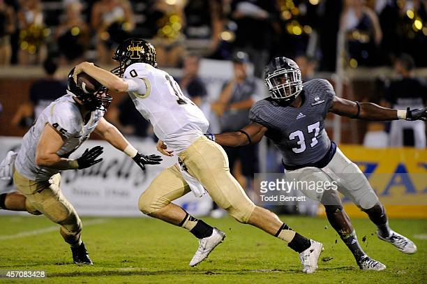 Quarterback Matt Linehan of the Idaho Vandals tries to elude linebacker Antwione Williams the Georgia Southern Eagles during the fourth quarter on...