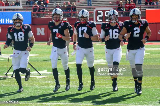 Quarterback Matt Masker of the Nebraska Cornhuskers and quarterback Luke McCaffrey and quarterback Andrew Bunch and quarterback Noah Vedral and...