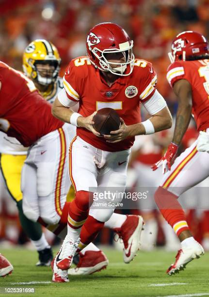 Quarterback Matt McGloin of the Kansas City Chiefs rolls out during the preseason game against the Green Bay Packers at Arrowhead Stadium on August...