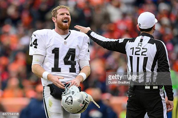 Quarterback Matt McGloin of the Oakland Raiders walks with his helmet off after being tackled in the second quarter of the game against the Denver...