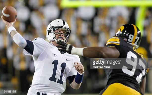 Quarterback Matt McGloin of the Penn State Nittany Lions drops back for a pass during the first quarter in front of defensive lineman Darian Cooper...