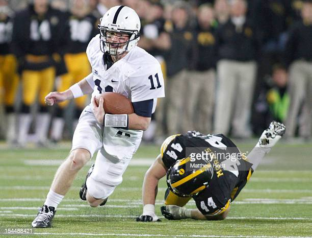 Quarterback Matt McGloin of the Penn State Nittany Lions rushes up the field during the fourth quarter in front of linebacker James Morris of the...