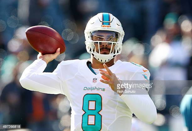 Quarterback Matt Moore of the Miami Dolphins looks to pass during warmups before taking on the Philadelphia Eagles at Lincoln Financial Field on...