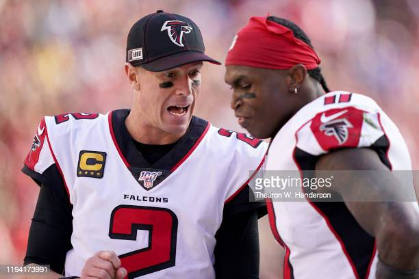 Quarterback Matt Ryan and wide receiver Julio Jones of the Atlanta Falcons talk on the sidlines during the game against the San Francisco 49ers at...