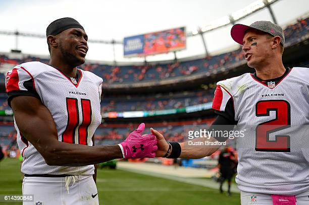 Quarterback Matt Ryan and wide receiver Julio Jones of the Atlanta Falcons walk off the field after a game against the Denver Broncos at Sports...
