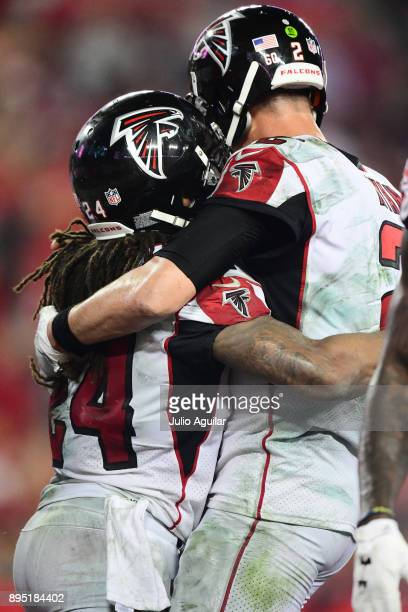 Quarterback Matt Ryan of the Atlanta Falcons and Running back Devonta Freeman celebrate after scoring in the fourth quarter against the Tampa Bay...