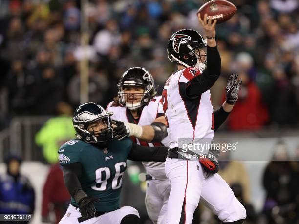 Quarterback Matt Ryan of the Atlanta Falcons attempts to throw a pass against defensive end Derek Barnett of the Philadelphia Eagles during the...