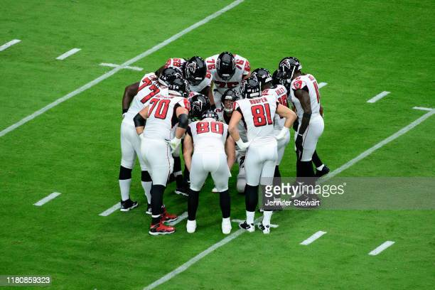 Quarterback Matt Ryan of the Atlanta Falcons calls a play in huddle during the first half against the Arizona Cardinals at State Farm Stadium on...