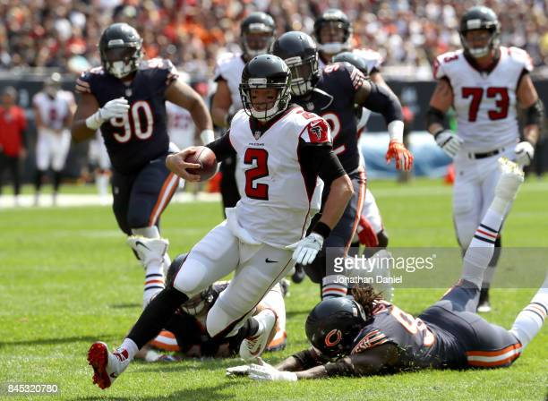 Quarterback Matt Ryan of the Atlanta Falcons carries the football against the Chicago Bears in the second quarter at Soldier Field on September 10...