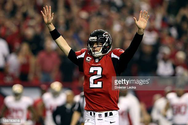 Quarterback Matt Ryan of the Atlanta Falcons celebrates after throwing a 20yard touchdown to wide receiver Julio Jones in the second quarter against...