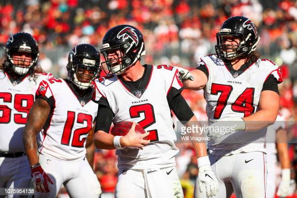 Quarterback Matt Ryan of the Atlanta Falcons celebrates with offensive tackle Ty Sambrailo after the touchdown pass from wide receiver Mohamed Sanu...