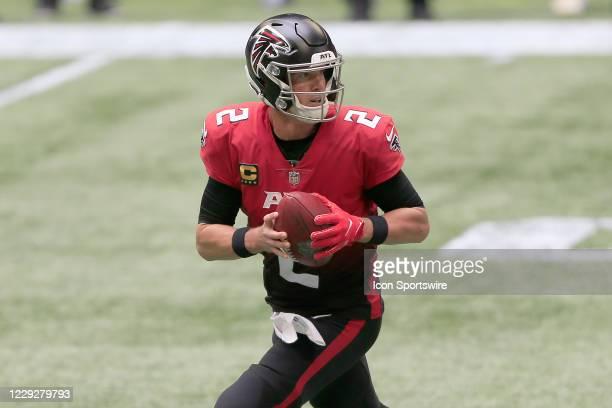 Quarterback Matt Ryan of the Atlanta Falcons drops back to pass during the week 7 NFL game between the Atlanta Falcons and the Detroit Lions on...