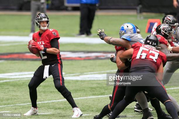Quarterback Matt Ryan of the Atlanta Falcons drops back to pass during the week 7 NFL game between the Atlanta Falcons and the Detroit Lions on...