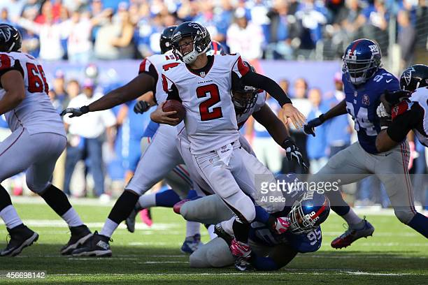 Quarterback Matt Ryan of the Atlanta Falcons gets sacked by defensive tackle Johnathan Hankins of the New York Giants in the fourth quarter of their...