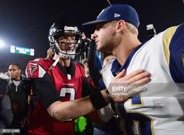 Quarterback Matt Ryan of the Atlanta Falcons greets quarterback Jared Goff of the Los Angeles Rams after the NFC Wild Card Playoff game at Los...