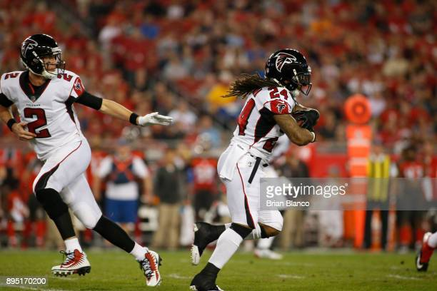 Quarterback Matt Ryan of the Atlanta Falcons hands off to running back Devonta Freeman during the first quarter of an NFL football game against the...