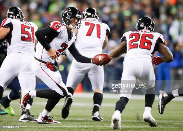 Quarterback Matt Ryan of the Atlanta Falcons hands off to Tevin Coleman against the Seattle Seahawks during the game at CenturyLink Field on November...