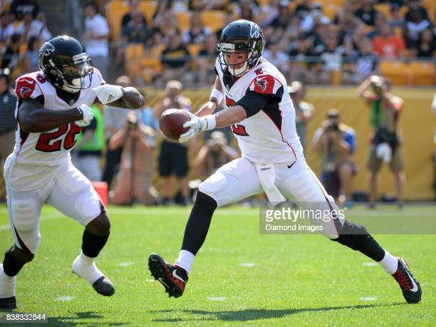 Quarterback Matt Ryan of the Atlanta Falcons hands the ball off to running back Tevin Coleman in the first quarter of a preseason game on August 20...