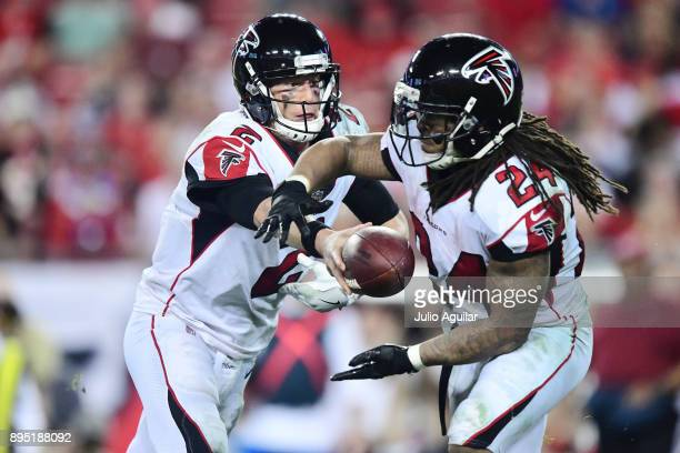 Quarterback Matt Ryan of the Atlanta Falcons hands the ball off to running back Devonta Freeman in the fourth quarter against the Tampa Bay...