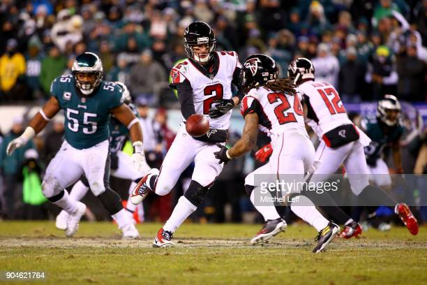 Quarterback Matt Ryan of the Atlanta Falcons hands the ball off to running back Devonta Freeman against the Philadelphia Eagles during the third...