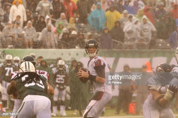Quarterback Matt Ryan of the Atlanta Falcons in action against the New York Jets in a heavy rain storm during their game at MetLife Stadium on...