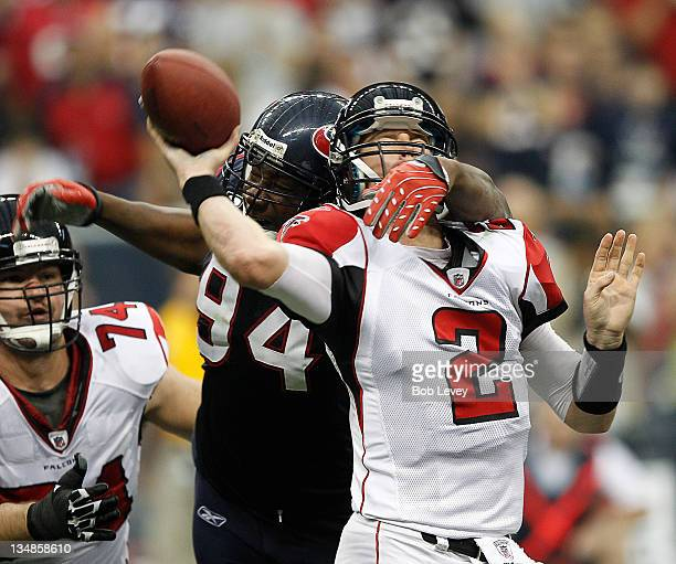 Quarterback Matt Ryan of the Atlanta Falcons is hit by Antonio Smith of the Houston Texans at Reliant Stadium on December 4 2011 in Houston Texas...