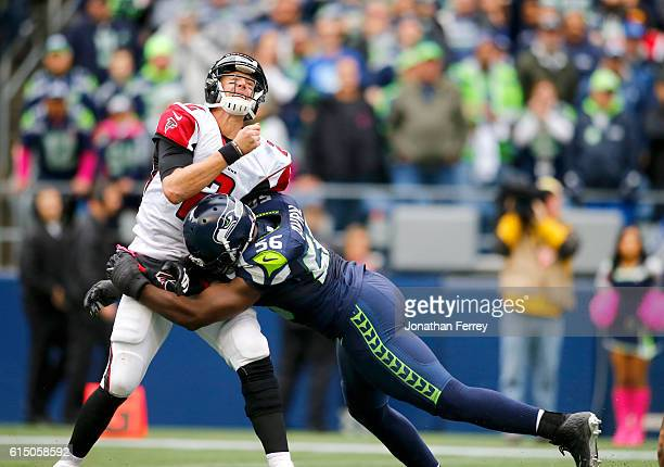 Quarterback Matt Ryan of the Atlanta Falcons is hit by defensive end Cliff Avril of the Seattle Seahawks at CenturyLink Field on October 16 2016 in...