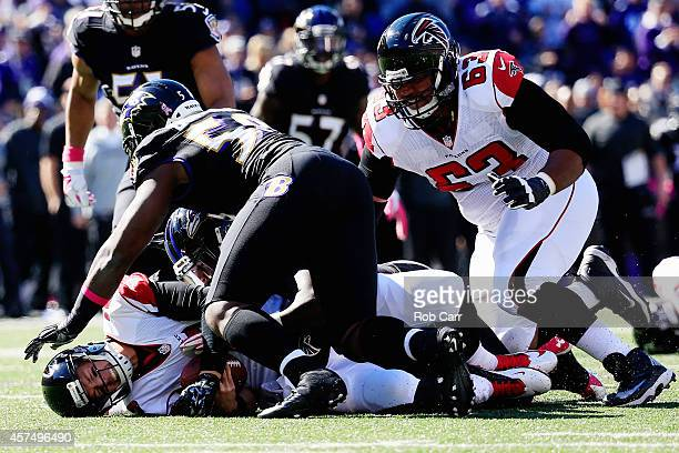 Quarterback Matt Ryan of the Atlanta Falcons is sacked in the second quarter by linebacker Pernell McPhee of the Baltimore Ravens at MT Bank Stadium...