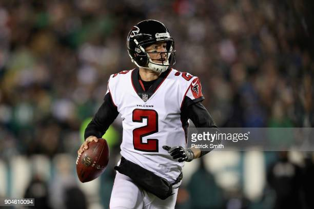 Quarterback Matt Ryan of the Atlanta Falcons looks to pass against the Philadelphia Eagles during the second quarter in the NFC Divisional Playoff...