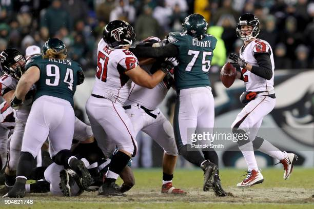Quarterback Matt Ryan of the Atlanta Falcons looks to pass against the Philadelphia Eagles during the third quarter in the NFC Divisional Playoff...