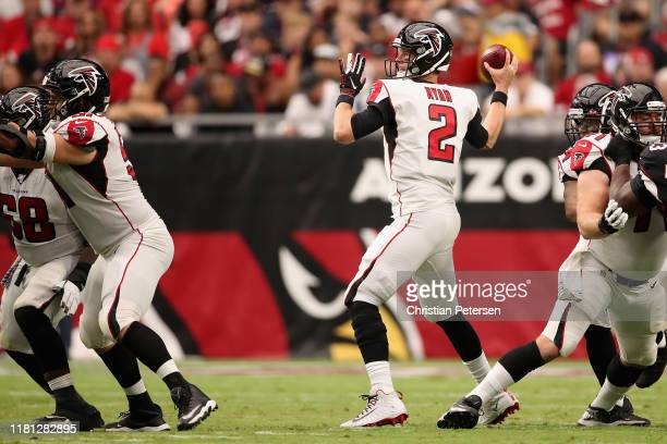 Quarterback Matt Ryan of the Atlanta Falcons looks to pass during the NFL game against the Arizona Cardinals at State Farm Stadium on October 13,...
