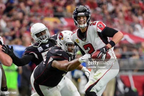 Quarterback Matt Ryan of the Atlanta Falcons looks to pass under pressure in the second half against the Arizona Cardinals at State Farm Stadium on...