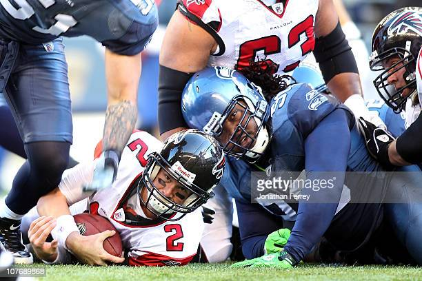 Quarterback Matt Ryan of the Atlanta Falcons looks to see if he made it past the first down marker on a 4th and 1 run Chris Cole ofthe Seattle...