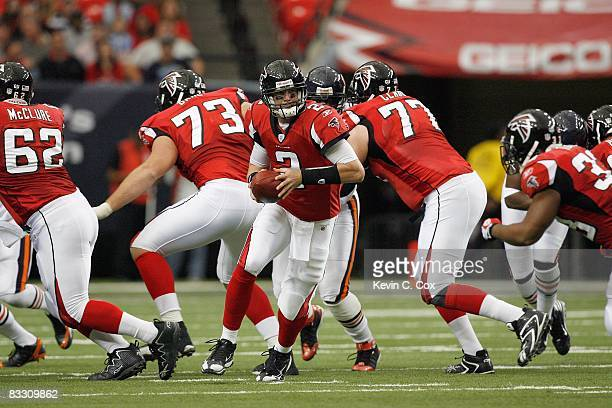 Quarterback Matt Ryan of the Atlanta Falcons moves back to hand off the ball during the game against the Chicago Bears at the Georgia Dome on October...