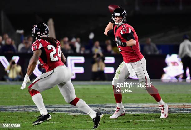 Quarterback Matt Ryan of the Atlanta Falcons prepares to pass to running back Devonta Freeman during the first quarter of the NFC Wild Card Playoff...