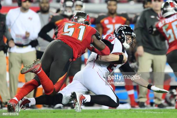 Quarterback Matt Ryan of the Atlanta Falcons runs for a first down past middle linebacker Kendell Beckwith of the Tampa Bay Buccaneers in the third...