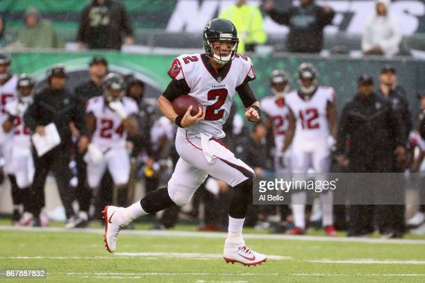 Quarterback Matt Ryan of the Atlanta Falcons runs the ball against the New York Jets during the first half of the game at MetLife Stadium on October...