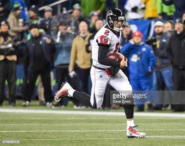 Quarterback Matt Ryan of the Atlanta Falcons rushes for a first down against the Seattle Seahawks during the third quarter of the game at CenturyLink...