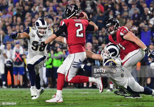 Quarterback Matt Ryan of the Atlanta Falcons sacked by outside linebacker Connor Barwin and nose tackle defensive end Morgan Fox of the Los Angeles...