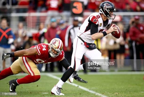 Quarterback Matt Ryan of the Atlanta Falcons scrambles against defensive end Solomon Thomas of the San Francisco 49ers during the game at Levi's...