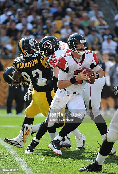 Quarterback Matt Ryan of the Atlanta Falcons scrambles as offensive lineman Sam Baker blocks linebacker James Harrison of the Pittsburgh Steelers...